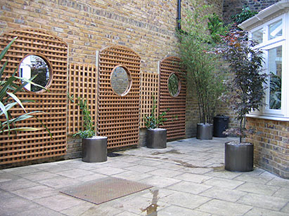 Budding ideas walled patio garden design for Garden patio designs